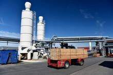 Forklift Transporting Planks I...