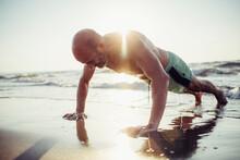 Senior Man Exercising At Beach...