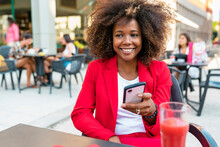 Smiling Woman Text Messaging W...