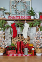Christmas Decorations And Stockings On The Fireplace Mantel