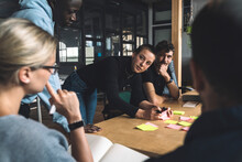Female Freelancer Discussing With Colleagues Over Start-up Strategy At Workplace