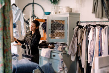 Female Customer Shopping At Fashion Store
