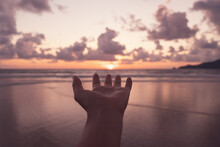 Woman Hand Reach Out To Sunset...