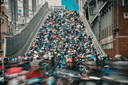 Fotografie, Obraz Motorcycles go down the Taipei bridge during rush hour in the morning