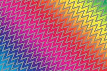 Abstract Textured Design Of Rainbow Zigzag Against A Gray Background.