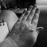 Fototapeta Kwiaty - hand of a person black and white