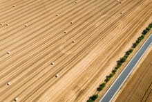 Abstract Aerial View Of Straw Bales In Field In Schernberg, Germany.