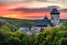 An Orange Twilight After Sunset Above The Famous Castle Karlstejn In Czech Republic.