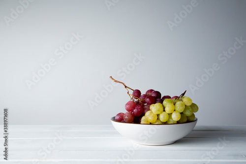 still life of red grapes on white wooden table Canvas