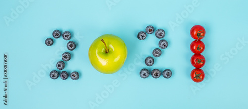 Obraz 2021 Happy New Year and New You with fruit and vegetable; Blueberries, green apple and Tomato on blue background. Goals, Healthy, Resolution, Time to New Start and dieting concept - fototapety do salonu