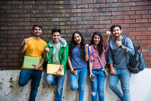 Education Is Fun - Cheerful Indian Asian Young Students Enjoying Togetherness In College Campus