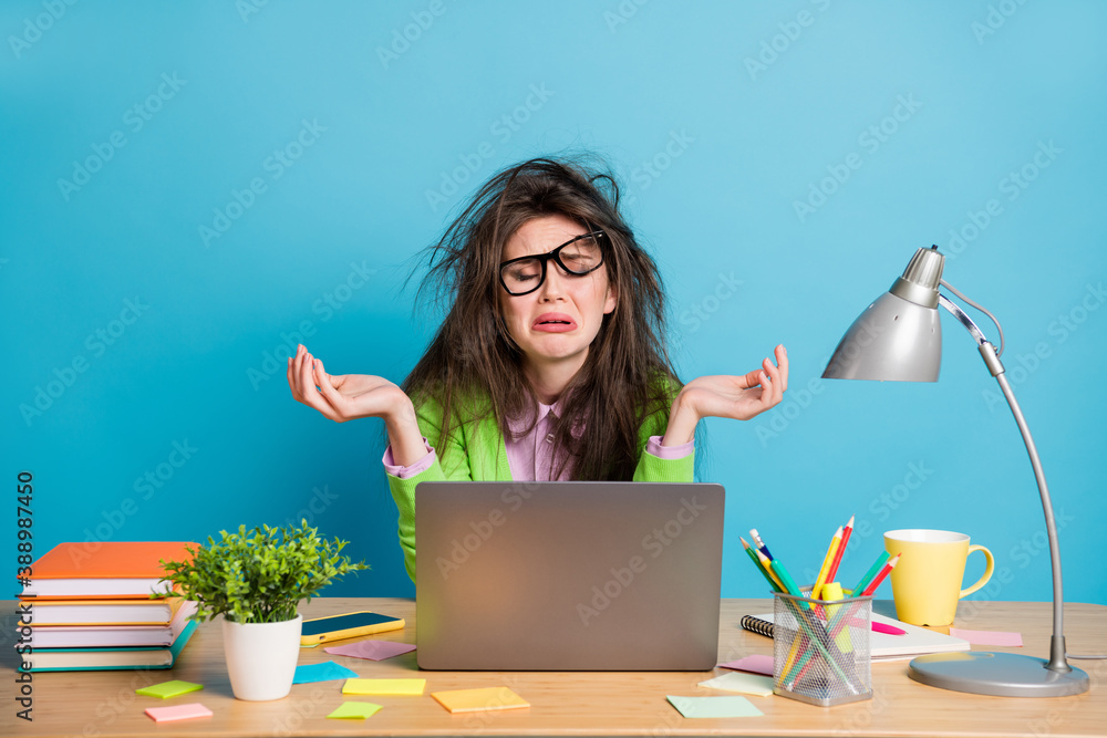Fototapeta Portrait of her she nice attractive devastated helpless girl doing home task crying bad mark failure isolated over bright blue color background
