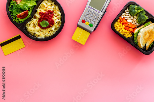 Fotografie, Tablou Food delivery payment with terminal and lunch boxes with meal