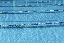 Sunny Outdoor Swimming Pool With Divided Pathes. Active Lifestyle And Activity. Sport Training And Competition Concept.