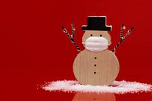 Snowman Wearing A Face Mask