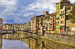 Cramped buildings lining a European canal