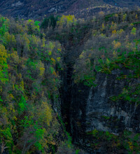 Deep And Narrow Gorge In A Mountain Side With Lush Green Vegetation On Both Sides Of The Ravine.