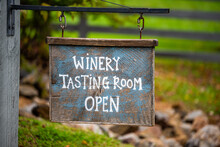 Closeup Of Winery Tasting Room Open Sign With Bokeh Background Of Grape Vineyard Winery Farm Landscape