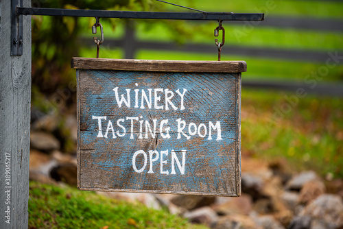 Canvas Print Closeup of Winery Tasting Room Open sign with bokeh background of grape vineyard