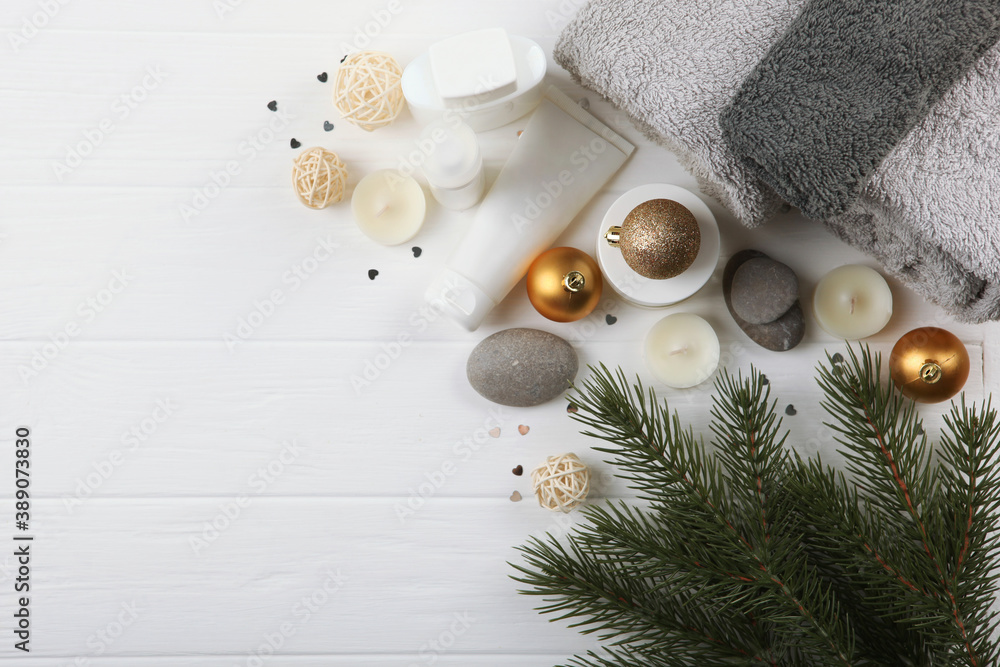 Fototapeta spa composition on the table and Christmas accessories. Relaxation care products. Skin care