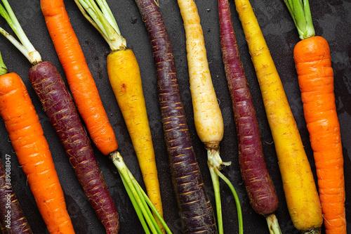 Tela Overhead view of raw organic multicolored carrots