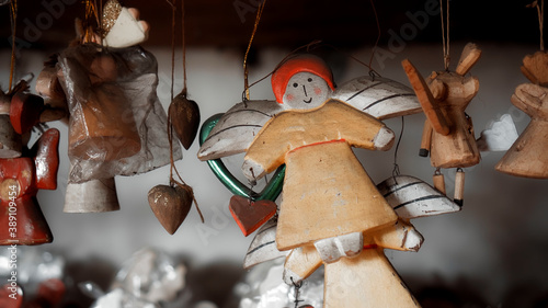 Christmas wooden colourise toys of angel hanging in the house Fototapet