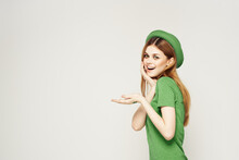 Girl In Green Clothes With Hat On Light Background St. Patrick's Day Cropped View