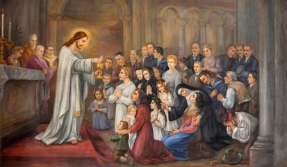 Fototapeta Dla Kościoła VIENNA, AUSTIRA - OCTOBER 22, 2020: The symbolic fresco Jesus give the communion in church Pfarrkirche Kaisermühlen from end of 19. cent.