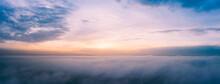 Orange Dawn Over The Clouds. A...