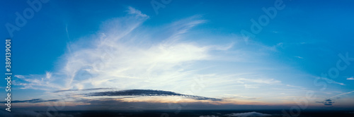 Obraz Dawn or sunset over the clouds, blue hour, aerial view. - fototapety do salonu