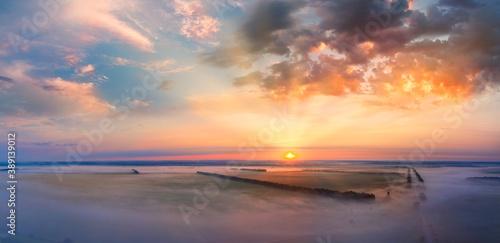 Canvas Dark orange sky, sunset, panorama. Storm clouds.