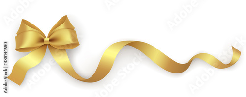 Decorative gold bow with ribbon on a white background. Holiday decoration design element for packaging, gift box, postcard, banner.