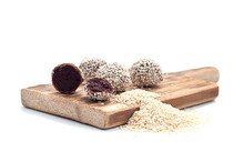 Healthy Raw Energy Balls With Cocoa, Chocolate, Flaxseed, On A White Textured Wooden Background. Chocolate Truffles.