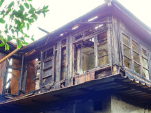 Fragment Of A Burnt Old Ruined Wooden House With Frames Without Glass