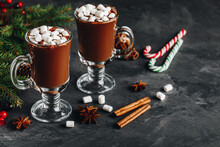 Hot Chocolate Cocoa With Marshmallow In Glass On Dark Background, Copy Space.