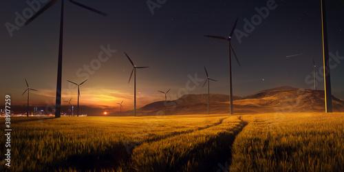 Papel de parede Beautiful sunset field with wind mill generators