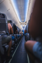 Long Dark Corridor In The Cabin Of A Low-cost Airline - Night Lighting During The Flight - Economy Class