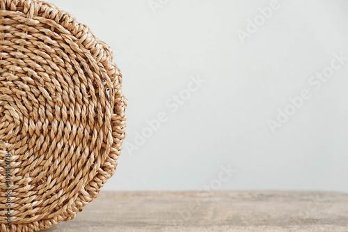 Fotografie, Obraz Details of a round wicker basket on an old wooden background