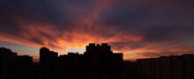 Scenic Sunset Over Dark City S...