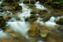 The Stream Of Water In The River Flowing Between The Rocks , Long Exposure Photo