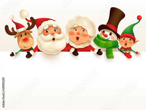Christmas companions Santa Claus, Mrs Claus, Reindeer, Elf and Snowman with big blank signboard Fotobehang