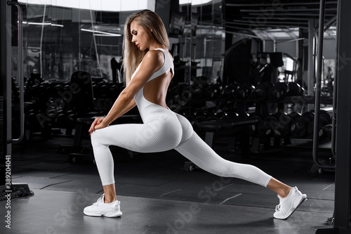 Tablou Canvas Fitness woman doing lunges exercises for leg muscle workout training in gym