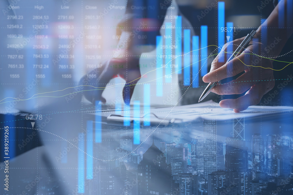 Fototapeta Businessman analyzing stock market report with financial graph on virtual screen for business finance and investment concept