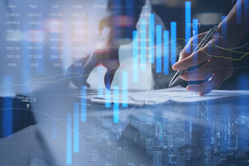 Obraz na płótnie Canvas Businessman analyzing stock market report with financial graph on virtual screen for business finance and investment concept