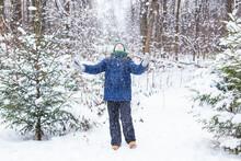Happy Boy Throwing Snow. Child, Season And Winter Concept.