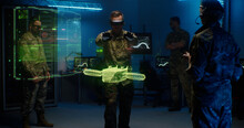Military Men Controlling Holographic Model Of Drone