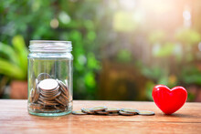 Glass Jar With Money Coins Set With Heart Model For Concept Donation And Philanthropy