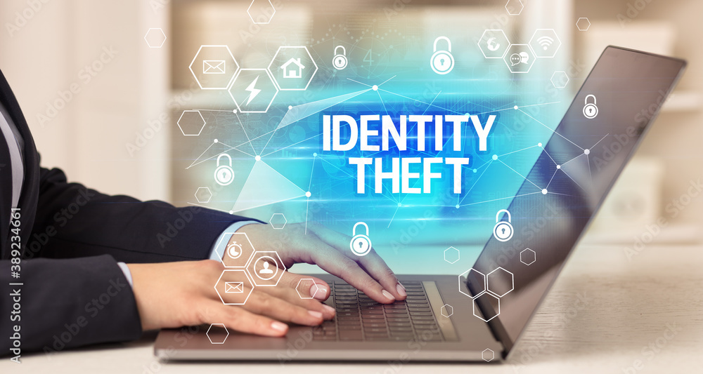 Fototapeta IDENTITY THEFT inscription on laptop, internet security and data protection concept, blockchain and cybersecurity