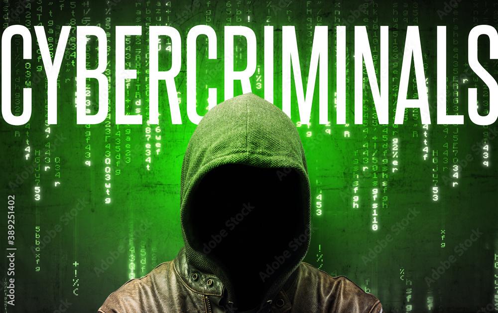 Fototapeta Faceless hacker with CYBERCRIMINALS inscription, hacking concept