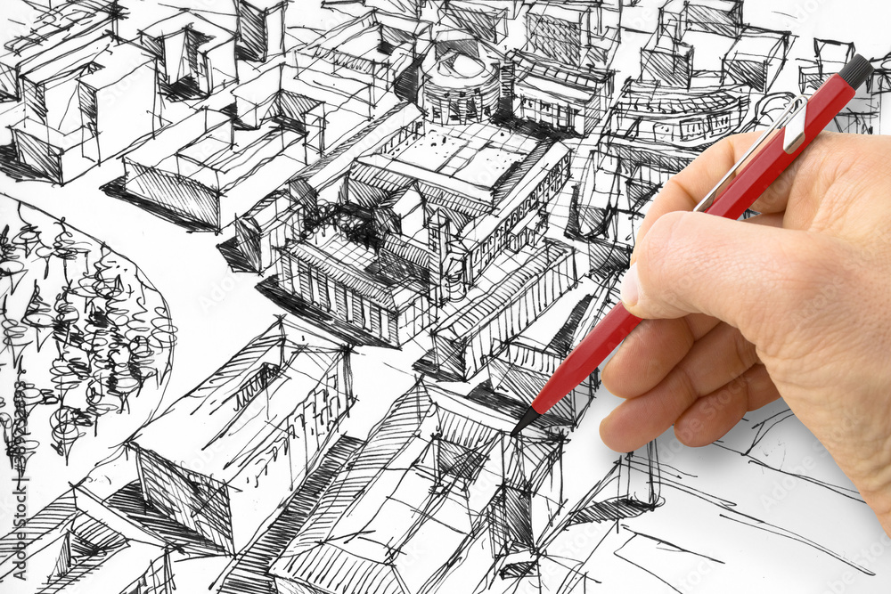 Fototapeta Planning a new city - Engineer-architect drawing with a pencil a sketch of a new modern imaginary town - concept image